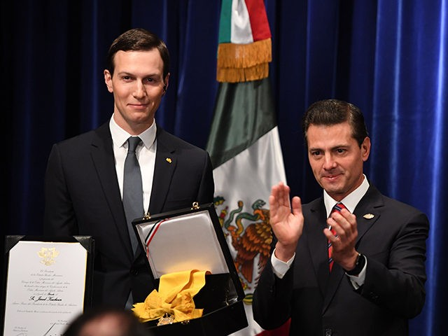 Senior Advisor to the President of the United States Jared Kushner (L) receives the Mexican Order of the Aztec Eagle from Mexico's President Enrique Pena Nieto in Buenos Aires, on November 30, 2018, in the sidelines of the G20 Leaders' Summit. - Mexico bestows its highest honor for foreign nationals …