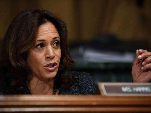 US Senator Kamala Harris, D-CA, talks to Christine Blasey Ford, the woman accusing Supreme Court nominee Brett Kavanaugh of sexually assaulting her at a party 36 years ago, during her hearing before the US Senate Judiciary Committee on Capitol Hill in Washington, DC, September 27, 2018. (Photo by SAUL LOEB …