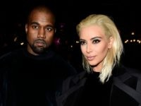 PARIS, FRANCE - MARCH 05: Kim Kardashian and Kanye West attend the Balmain show as part of the Paris Fashion Week Womenswear Fall/Winter 2015/2016 on March 5, 2015 in Paris, France. (Photo by Pascal Le Segretain/Getty Images)