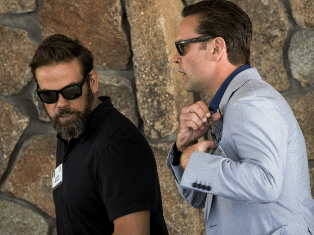(L to R) Lachlan Murdoch, executive co-chairman of News Corp and 21st Century Fox, walks with brother James Murdoch, chief executive officer of 21st Century Fox, as they attend the annual Allen & Company Sun Valley Conference, July 5, 2016 in Sun Valley, Idaho. Every July, some of the world's …