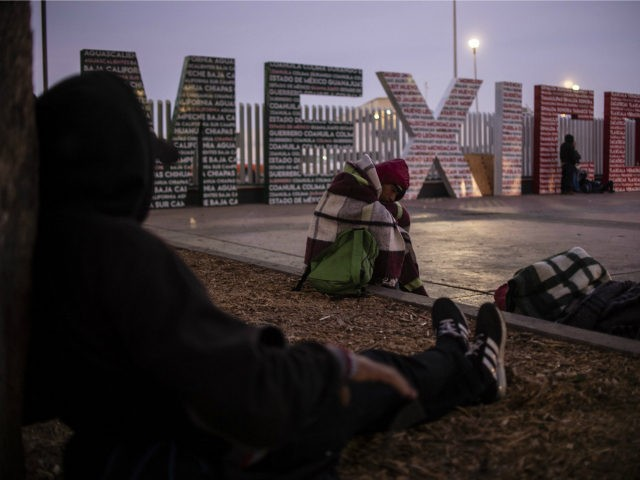 A group of Central American migrants - mostly from Honduras - moving towards the United States, rest near El Chaparral port of entry at the US-Mexico border in Tijuana, Baja California state, Mexico, on November 23, 2018. - Hundreds of Central American migrants staged a boisterous demonstration on the US …