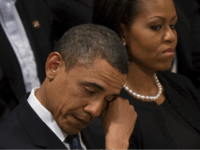 US President Barack Obama wipes away a tear as he sits next to First Lady Michelle Obama at the funeral service for Dr Dorothy Height at Washington National Cathedral in Washington, DC, April 29, 2010. Height, who led the National Council for Negro Women for four decades, and was present …