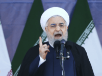 Iran's President Hassan Rouhani speaks at a military parade marking the 38th anniversary of Iraq's 1980 invasion of Iran, in front of the shrine of the late revolutionary founder, Ayatollah Khomeini, outside Tehran, Iran, Saturday, Sept. 22, 2018. Elsewhere gunmen disguised as soldiers attacked a annual parade in the southwestern …