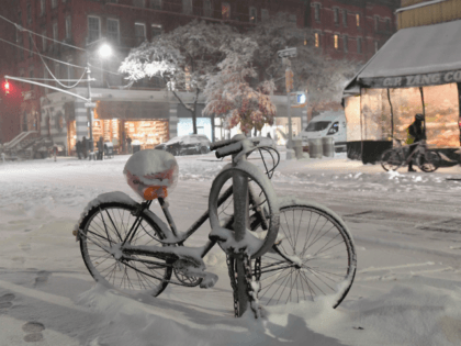 A bicycle covered in snow is seen in Manhattan on November 15, 2018 in New York . - The National Weather Service is predicting snowfall totals of 2 to 4 inches in New York City. (Photo by Angela Weiss / AFP) (Photo credit should read ANGELA WEISS/AFP/Getty Images)