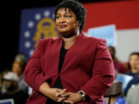 Georgia gubernatorial candidate Stacey Abrams watch as former President Barack Obama speaks during a campaign rally at Morehouse College Friday, Nov. 2, 2018, in Atlanta. (AP Photo/John Bazemore)