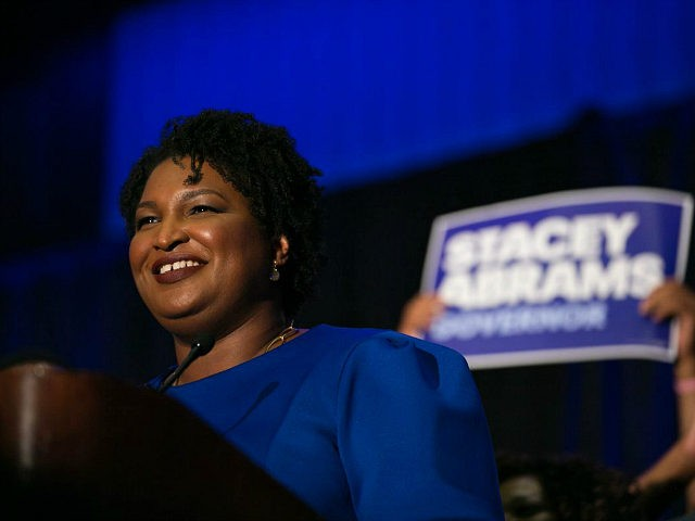ATLANTA, GA - MAY 22: Georgia Democratic Gubernatorial candidate Stacey Abrams takes the stage to declare victory in the primary during an election night event on May 22, 2018 in Atlanta, Georgia. If elected, Abrams would become the first African American female governor in the nation. (Photo by Jessica McGowan/Getty …