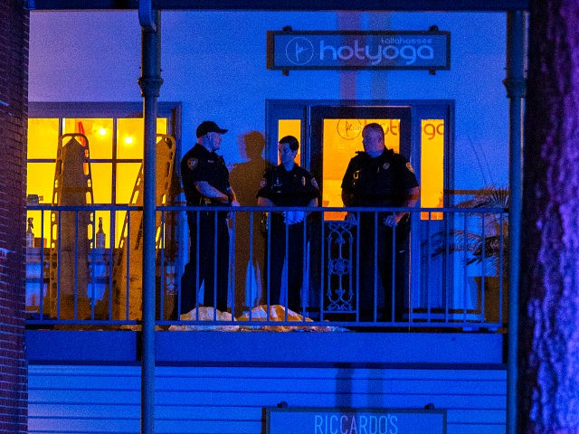 TALLAHASSEE, FL - NOVEMBER 02: Tallahassee Police officers are stationed outside the HotYoga Studio after a gunman killed one person and injured several others inside on November 2, 2018 in Tallahassee, Florida. The gunman also died from what appears a self inflicted gunshot wound according to police. (Photo by Mark …
