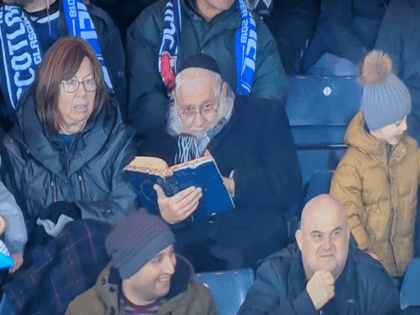 """TEL AVIV - The old adage """"Football is life. The rest is mere details"""" clearly doesn't ring true for one rabbi who was caught on a stadium camera at an Israel-Scotland game in Glasgow deep in Talmudic study just after the away team scored a goal."""