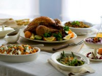 FILE- This Oct. 13, 2011 file photo shows a citrus turkey surrounded by side dishes in Concord. N.H. No need for a salt shaker on the Thanksgiving table: Unless you really cooked from scratch, there's lots of sodium already hidden in all the turkey and trimmings. (AP Photo/Matthew Mead, FIle)