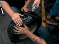 Tom Burkhart, and Johnnie Harrison, of Karnes Pro Tire and Auto Center, fix flat tires of all sizes on May 25, 2011 in Joplin, Missouri. The company has been fixing flat tires without charge since Monday morning. 'At first we were just helping emergency crews,' Burkhart said. 'But now we …