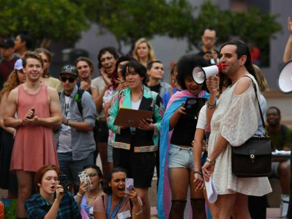 Members of the Transgender community and their supporters hold a rally and march to City Hall before the mid-term elections to protest against what they say are continual attacks from the Trump administration, in Los Angeles, California on November 2, 2018. (Photo by Mark RALSTON / AFP) (Photo credit should …