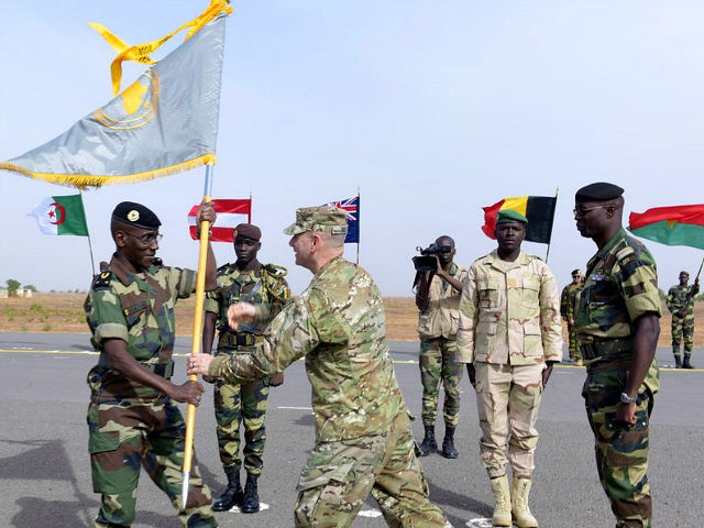 Senegal's Army General Amadou Kane (L) receives the 2016 Flintlock flag from US Army General Donald Bolduc during the inauguration of a military base in Thies, 70 km from Dakar, on February 8, 2016 on the second day of a three-week joint military exercise between African, US and European troops, …