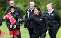 Meghan hurled her boot past her husband's on a rain-soaked paddock
