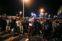 Venezuelans line up outside an immigration office in Tumbes, Peru, near the border with Ecuador