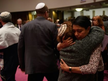 As Pittsburgh congregations observed their first Shabbat on Friday since a gunman killed 11 people at the Tree of Life synagogue, people greeted each other at the Temple Sinai, only blocks away from the massacre scene