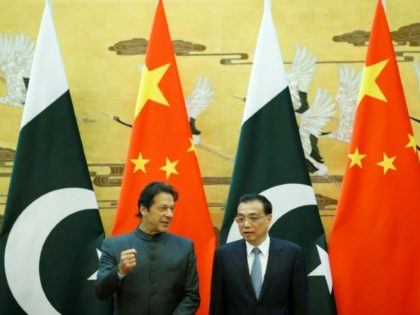 Pakistani Prime Minister Imran Khan and China's Premier Li Keqiang attend a signing ceremony at the Great Hall of the People in Beijing
