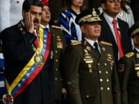 "Venezuelan Minister of Defence General Vladimir Padrino (C), pictured with President Nicolas Maduro (L) on August 4, 2018, criticized Colombia for being ""unable to control its groups, its violence and its drug trafficking"""