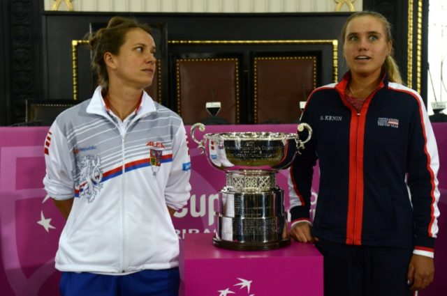 Czech Barbara Strycova (L) eyes her opponent for Saturday's opening rubber, American Sofia Kenin, as both stand next to the Fed Cup trophy which will be decided this weekend.