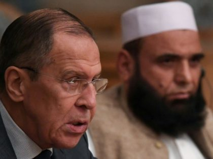 This is the first time that a Taliban delegation is taking part in such high-level international talks, the office of Russia's Foreign Minister Sergei Lavrov (L) said