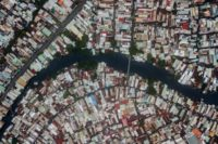 Ho Chi Minh City boasts large sprawling communities living along polluted waterways