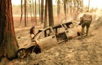 """Sheriff deputies discovered remains inside a vehicle torched by the """"Camp Fire"""" near the small town of Concow, California"""