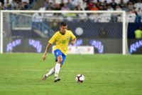 Brazil midfielder Philippe Coutinho, playing here against Saudi Arabia last month, is one of three players to drop out of Tite's squad through injury