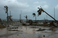 The study suggests that climate change will increase the amount of rain produced by tropical storms and hurricanes