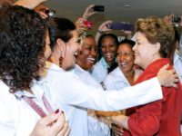 Then-president Dilma Rousseff of Brazil greets Cuban doctors after approving the More Doctors program with Cuba