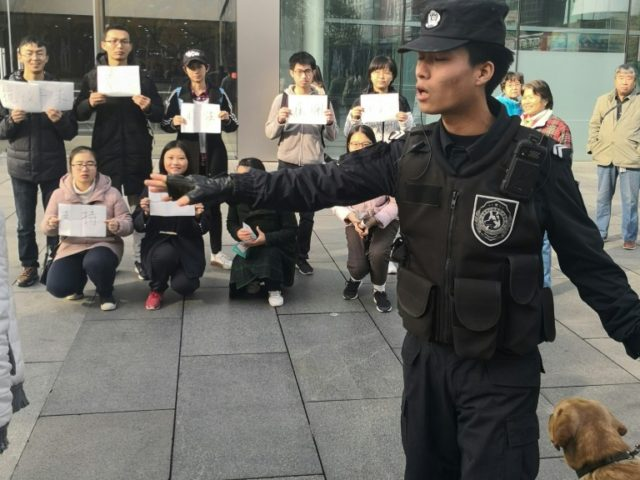 Any hint of campus activism in China sparks deep concern among authorities. This picture from November 8 shows demonstrating students outside an Apple Store in Bejing