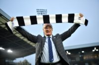 Fulham's new manager Claudio Ranieri poses with a team scarf on the pitch at the club's Craven Cottage stadium on November 16, 2018 after replacing sacked Slavisa Jokanovic.