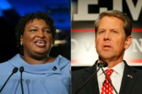 Stacey Abrams announced she will not win her bid to become the first black governor, but aimed fiery criticism at rival Brian Kemp