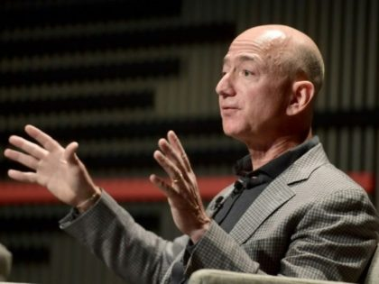 The European Parliament has appealed to Jeff Bezos (pictured October 2018) to stop selling items with Soviet hammer and sickle symbols on Amazon, after American retail giant Walmart pledged to do so