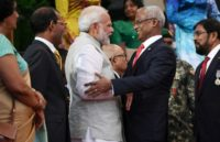 New Maldives President Ibrahim Mohamed Solih (R) and Indian Prime Minister Narendra Modi (L) pledged to work together on the problems faced by the nation of small islands and atolls