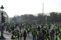 "Protesters massed on the Place de la Concorde in central Paris on Saturday during the ""yellow vest"" protests against high fuel prices in France"