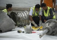 Investigators examine engine parts from the ill-fated Lion Air flight JT 610, after they were recovered from the bottom of the Java Sea