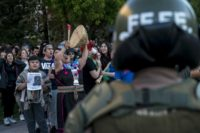 Students and Mapuche activists demand the resignation of Chile's Interior Minister Andres Chadwick following the death of a young Mapuche man in a police operation, in Santiago, on November 19, 2018