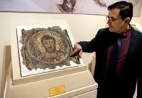 Director of the Cyprus Byzantine Museum Ioannis Eliades shows a centuries-old mosaic of Saint Mark in Nicosia on November 21, 2018
