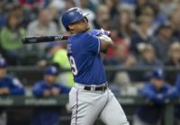 Dominican slugger Adrian Beltre of the Texas Rangers, shown hitting a double in September, announced his retirement Tuesday after 21 Major League Baseball seasons