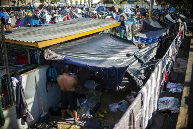 Thousands of Central American migrants hoping to reach the United States in search of a better life have been camping at a makeshift shelter at the Mexico-US border