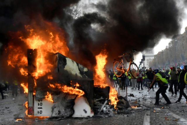 "Clashes on the Champs-Elysees between police and ""Yellow vests"" demanding the government reverse a fuel tax hike they say hits the poorest hardest"