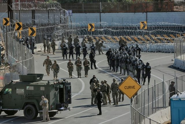 US troops and border patrol agents rushed to a border crossing between San Diego, California and Tijuana, Mexico to stop hundreds of migrants trying to clamber over border fences