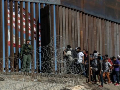 Central American migrants seeking asylum reach the US border at the Mexican city of Tijuana on November 25, 2018