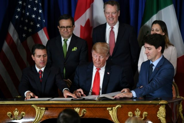 The USMCA - the new NAFTA trade agreement - was signed in Buenos Aires on November 30, 2018 by (L to R) Mexican President Enrique Pena Nieto, US President Donald Trump and Canadian Prime Minister Justin Trudeau