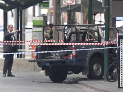 A burnt out vehicle is seen on Bourke Street in Melbourne, Friday, Nov. 9, 2018. A knife-wielding man stabbed two people, one fatally, in Australia's second-largest city on Friday in an attack likely linked to terrorism, police said. The attack during the afternoon rush hour brought central Melbourne to a …