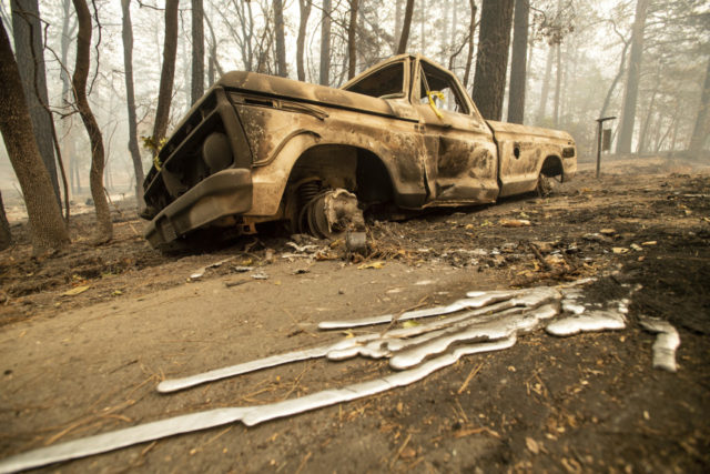 N. California fire officials begin agonizing search for dead