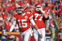 The Latest: Chiefs Mahomes ups TD total to 31 to pass Dawson