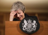 UK's May appeals to public on Brexit, braces for more blows