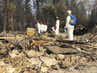 Hundreds search rubble in California for human remains