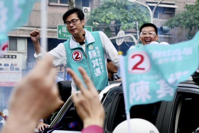 In this Nov. 20, 2018, photo, Democratic Progressive Party Kaohsiung mayoral candidate, Chen Chi-mai at left reacts to supporters during a rally in Kaohsiung, central Taiwan. China and its growing pressure campaign loom large as Taiwan holds elections for mayors and other local officials Saturday, in what is partly seen …