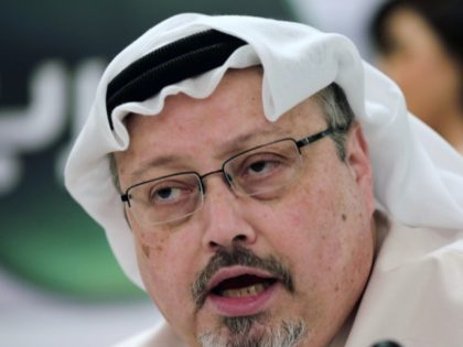In this Dec. 15, 2014, file photo, Saudi journalist Jamal Khashoggi speaks during a press conference in Manama, Bahrain. President Donald Trump says the U.S. will not levy additional punitive measures at this time against Saudi Arabia over the killing of Jamal Khashoggi. (AP Photo/Hasan Jamali, File)